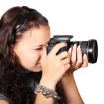 girl_taking_pictures_facing_in