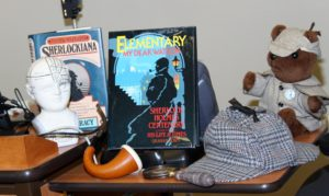 Sherlock Holmes teddy bear, Sherlock Holmes pipe, magnifying glass, The Enclyclopedia of Sherlockiana, Elementary My Dear Watson book, deerstalker