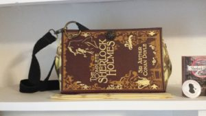 woman's handbag made from a vintage Sherlock Holmes book