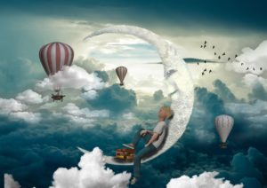 boy sits on crescent moon dreaming